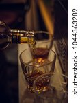 alcohol and glass | Shutterstock . vector #1044363289