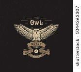 handmade owl and ribbon.... | Shutterstock .eps vector #1044363307