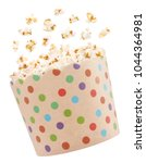 popcorn in spotted dotted... | Shutterstock . vector #1044364981