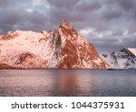 mountain ridge and reflection... | Shutterstock . vector #1044375931