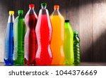 plastic bottles of assorted... | Shutterstock . vector #1044376669