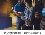 group adult hipsters using in... | Shutterstock . vector #1044380041