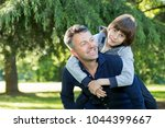 portrait of father with his son ... | Shutterstock . vector #1044399667
