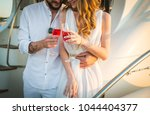happy bride and groom drinking...   Shutterstock . vector #1044404377