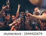 group of friends celebrating...   Shutterstock . vector #1044422674