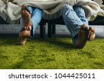 cropped shot of barefoot... | Shutterstock . vector #1044425011