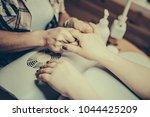 female hands applying hand... | Shutterstock . vector #1044425209