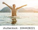 child splashing in summer sea | Shutterstock . vector #1044428221