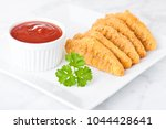 fried chicken dippers on... | Shutterstock . vector #1044428641