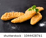 fried chicken dippers on stone... | Shutterstock . vector #1044428761