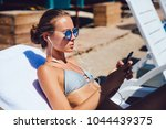 charming woman in swimsuit ... | Shutterstock . vector #1044439375