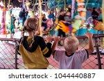 Kids In Front Of Carosel
