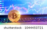 bitcoin on laptop with chart... | Shutterstock . vector #1044453721