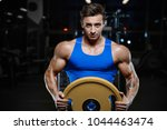 handsome young fit muscular... | Shutterstock . vector #1044463474