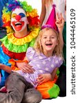 Small photo of Birthday child clown playing with children and bunny fingers prank. Kid holiday cakes celebratory and balloons the happiest birthday. Mom arranged party for her daughter.