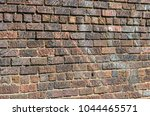 brick wall with dark and light... | Shutterstock . vector #1044465571