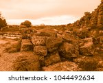 golden view of the ruins of side | Shutterstock . vector #1044492634