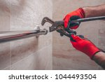 working plumber unscrews the... | Shutterstock . vector #1044493504