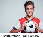 photo of smiling teen boy in... | Shutterstock . vector #1044501157