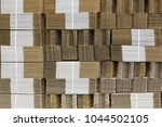 corrugate cardboard tied with... | Shutterstock . vector #1044502105