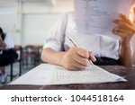 students writing and reading... | Shutterstock . vector #1044518164