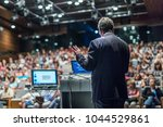 speaker giving a talk on... | Shutterstock . vector #1044529861