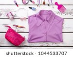 folded purple shirt and pink... | Shutterstock . vector #1044533707