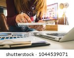 designer woman using smart... | Shutterstock . vector #1044539071