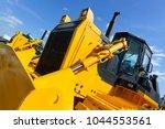 bulldozer  row of huge yellow... | Shutterstock . vector #1044553561