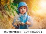baby boy in a blue jacket...   Shutterstock . vector #1044563071