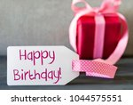 pink gift  label  text happy... | Shutterstock . vector #1044575551
