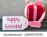 pink gift  label  text happy... | Shutterstock . vector #1044575551
