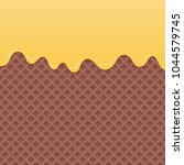 flowing yellow cream on... | Shutterstock .eps vector #1044579745