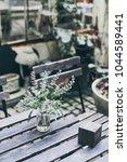 flower in vase decoration on... | Shutterstock . vector #1044589441