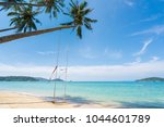 swing hang from coconut palm... | Shutterstock . vector #1044601789