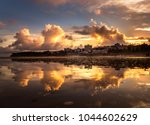 reflection of sky and clouds in ... | Shutterstock . vector #1044602629