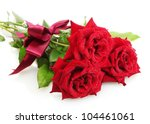 Stock photo three beautiful red roses with drops isolated on white 104461061
