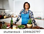 african woman in the kitchen | Shutterstock . vector #1044620797