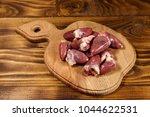 raw chicken hearts on cutting... | Shutterstock . vector #1044622531
