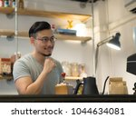 asian man being barista and own ... | Shutterstock . vector #1044634081