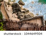 stairs. descent to the ocean.... | Shutterstock . vector #1044649504