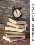 vintage metal alarm clock with...   Shutterstock . vector #1044674341