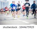 silhouette man running marathon  | Shutterstock . vector #1044675925