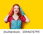 redhead housewife with gloves...   Shutterstock . vector #1044676795