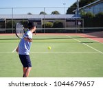 Action Child Playing Tennis...