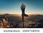 woman does yoga exercises on... | Shutterstock . vector #1044718924