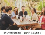 group of friends hang out in... | Shutterstock . vector #1044731557