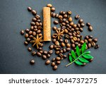 coffee beans and cinnamon and... | Shutterstock . vector #1044737275