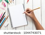 girl hand drawing  blank paper... | Shutterstock . vector #1044743071