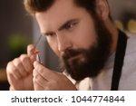 jeweler working in workshop ... | Shutterstock . vector #1044774844